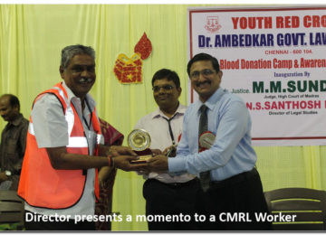 Director presents a momento to a CMRL Worker