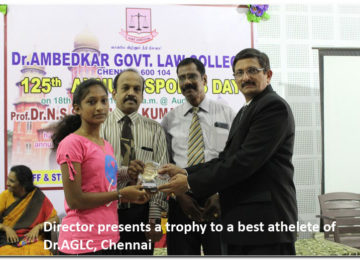 Director presents a trophy to a best athlete of DR.AGLC, Chennai