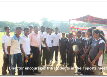 Director encourages the students in their sports meet