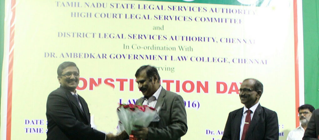 The Director honouring Mr.Justice Kuluvadi Ramesh on the constitution Day Celebration.